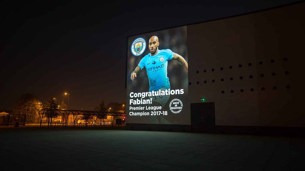 24 foot Premiership footballer projection encourages pupils to aim high