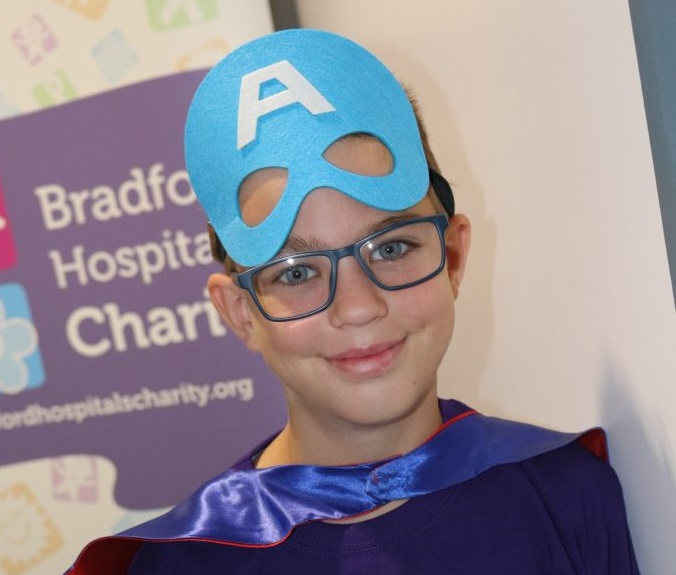 Daredevil pupil abseils down hospital for charity